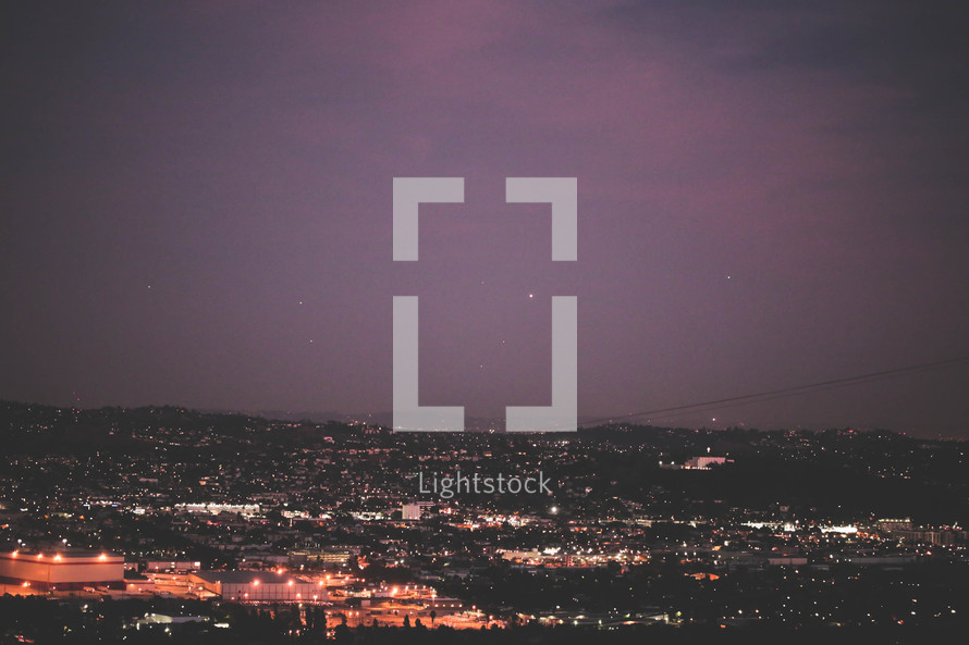 6ec26d7d20b Light from a city below at night — Photo — Lightstock