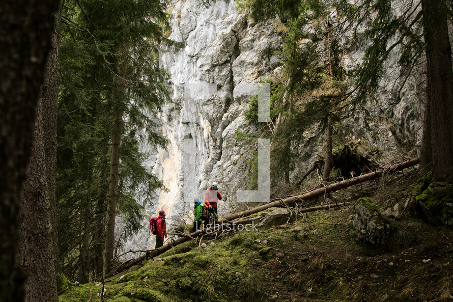 man walking up the side of a mountain
