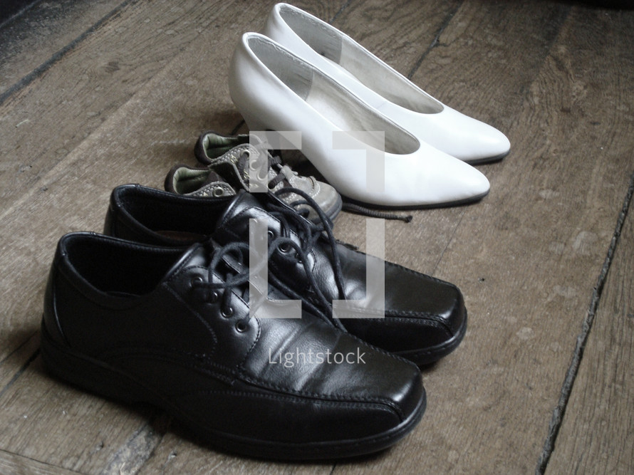 family - shoes,  familiy, shoes, parents, child, size, different, baby, father, mother, home, floor, wood, wooden flooring, black, white, brown, pumps, toddler
