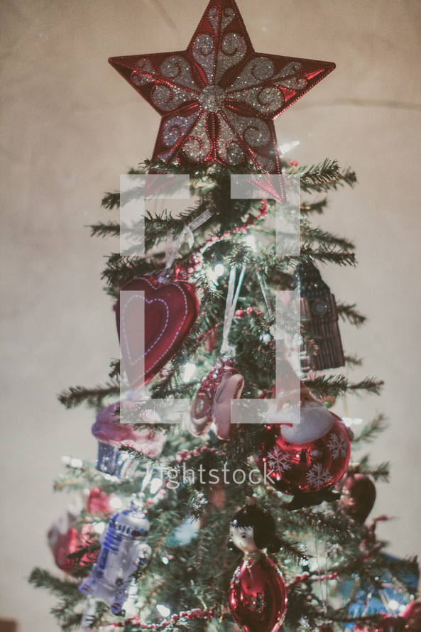 A decorated Christmas tree with a star on top