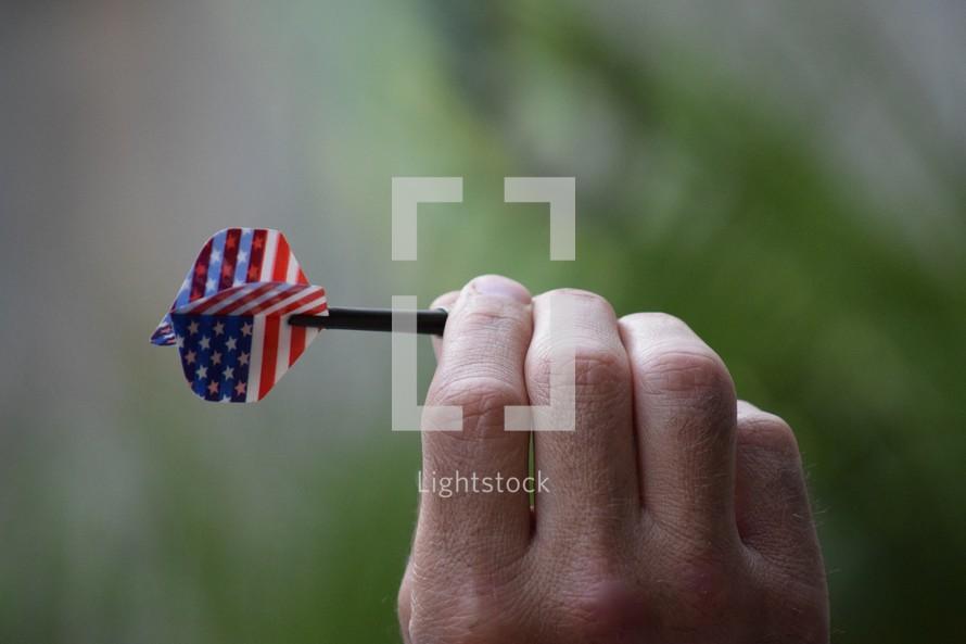 a man throwing a dart