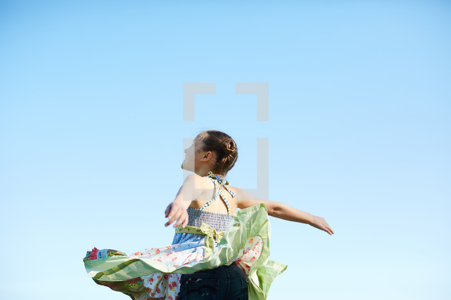 a girl dancing in a field