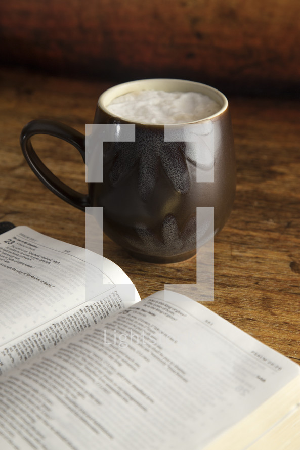open Bible and latte