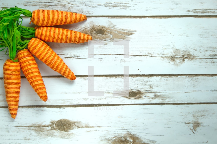carrot decorations on white wood boards