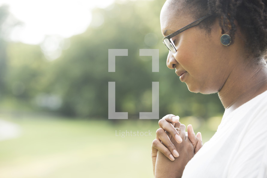 African-American woman with praying hands