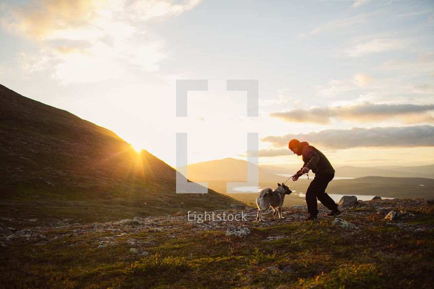 a man and his dog on a hike