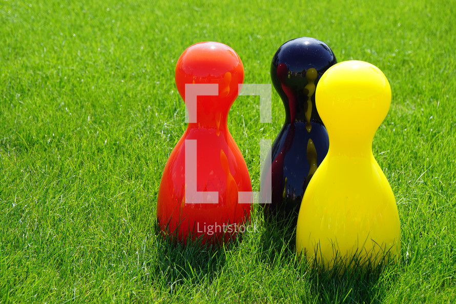 bowling pins in grass