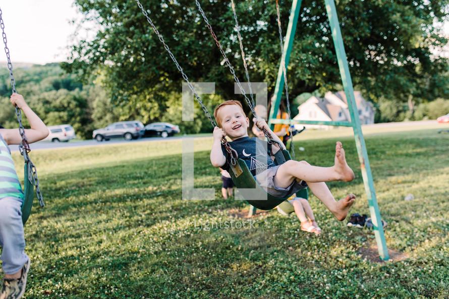 kids on a swing set