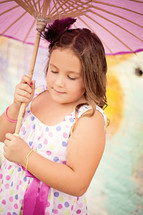 girl child holding a parasol