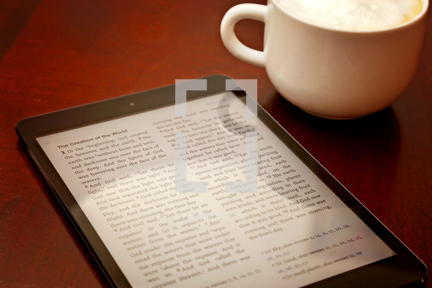 Bible app and coffee on a wood table