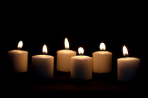six candles in darkness