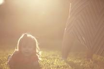 toddler girl and intense sunlight