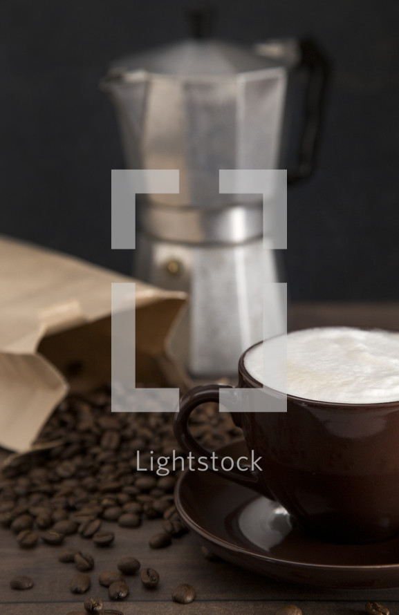 Foam Topped Coffee on a Wooden Table