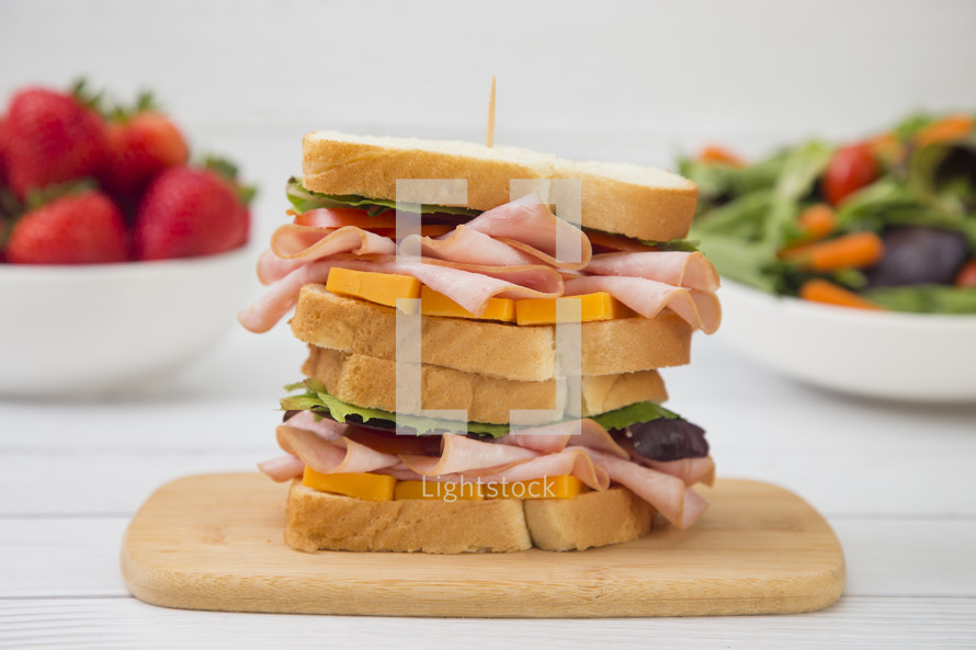 stacked ham and cheese sandwich