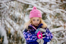 toddler girl in a winter snowsuit