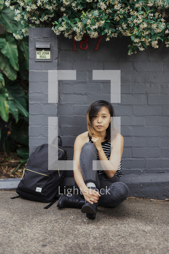 a young woman with a book bag