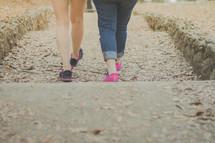 Two women walking down an old street