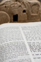 New Testament in Hebrew and English with Tomb in the Background