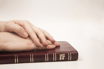 hands on a Bible