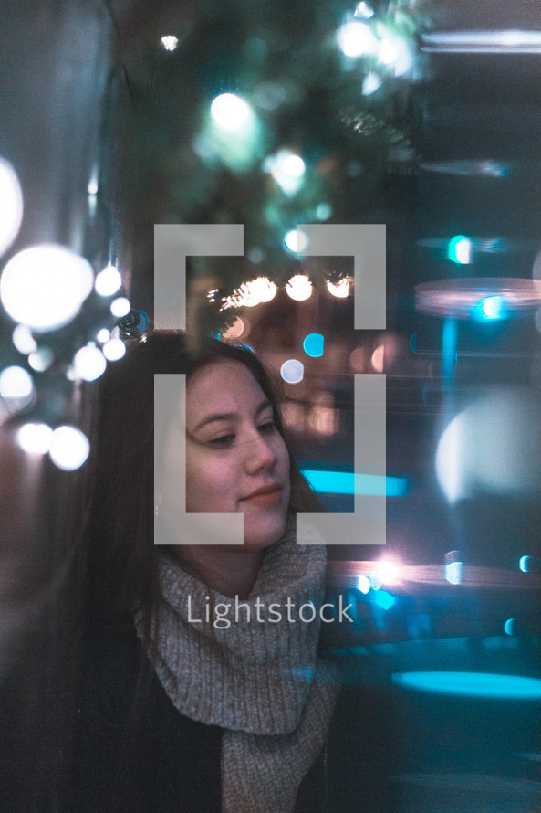 young woman standing outdoors at night