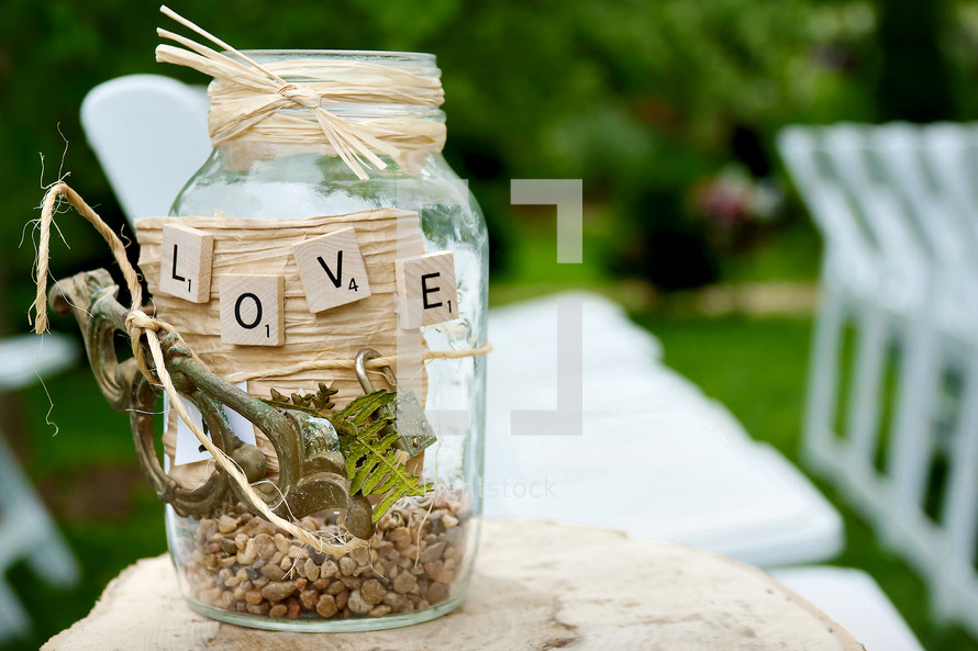 decorated mason jar with the word LOVE