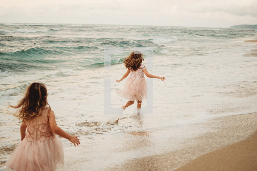 girls running in the tide
