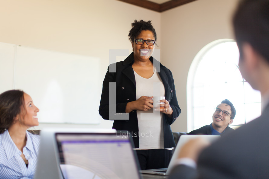 career woman leading a meeting