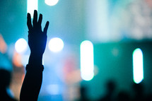 silhouette of a raised hand in praise.