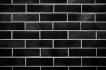 Minimal black texture brick wall background