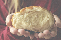 cupped hands holding bread