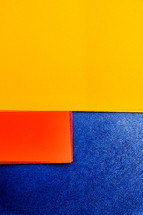 yellow, red, blue paper