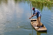 man fishing with a rustic fishing pole