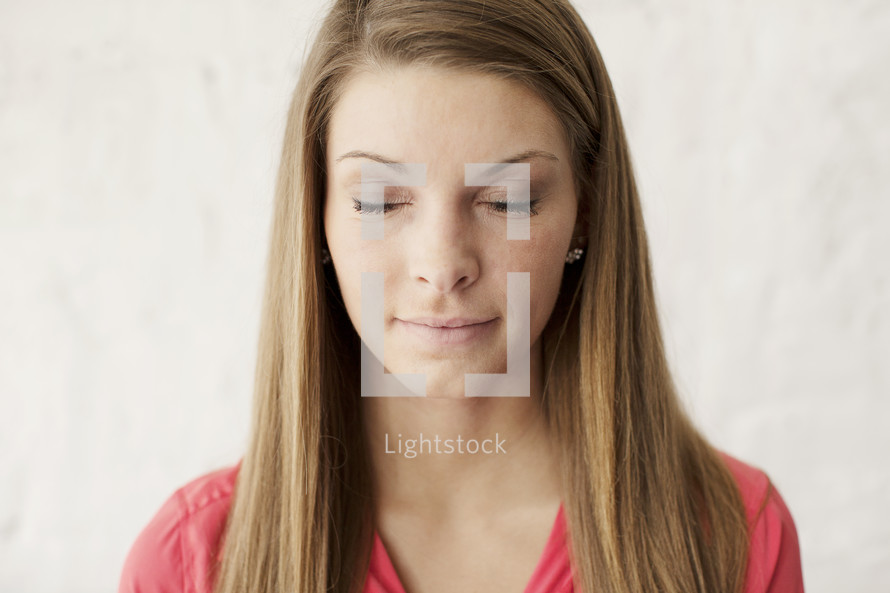 young brunette woman with closed eyes