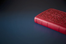 red Bible on a table