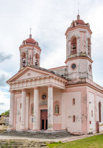 pink church with bell towers