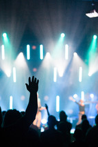 hands raised in worship at a christian rock concert