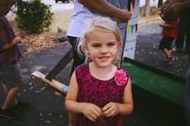 A blonde little girl.