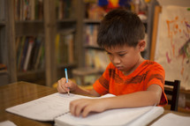 child working on his homework
