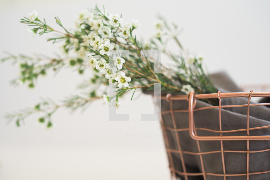 flowers in a wire basket
