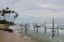 Stilts along a beach for fishing