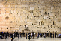 Crowd of people worshipping at the Western or Wailing Wall in Jerusalem.