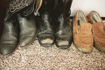 boots and shoes on carpet