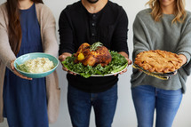 people holding thanksgiving food