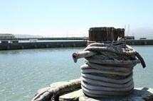 rope around a post on a pier
