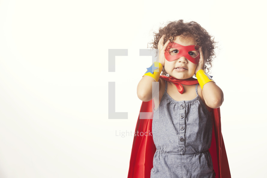 Child dressed as a superhero.