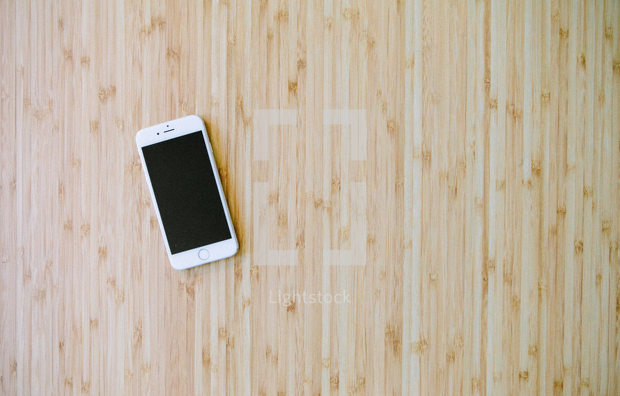 iPhone on a bamboo floor