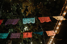 colorful lace banner outdoors at night