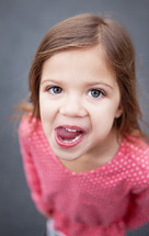 girl child sticking her tongue out