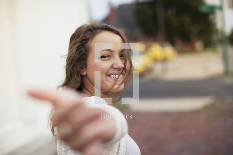a young woman with outstretched hand