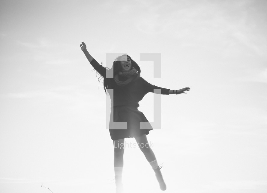 A young woman jumping in the air.